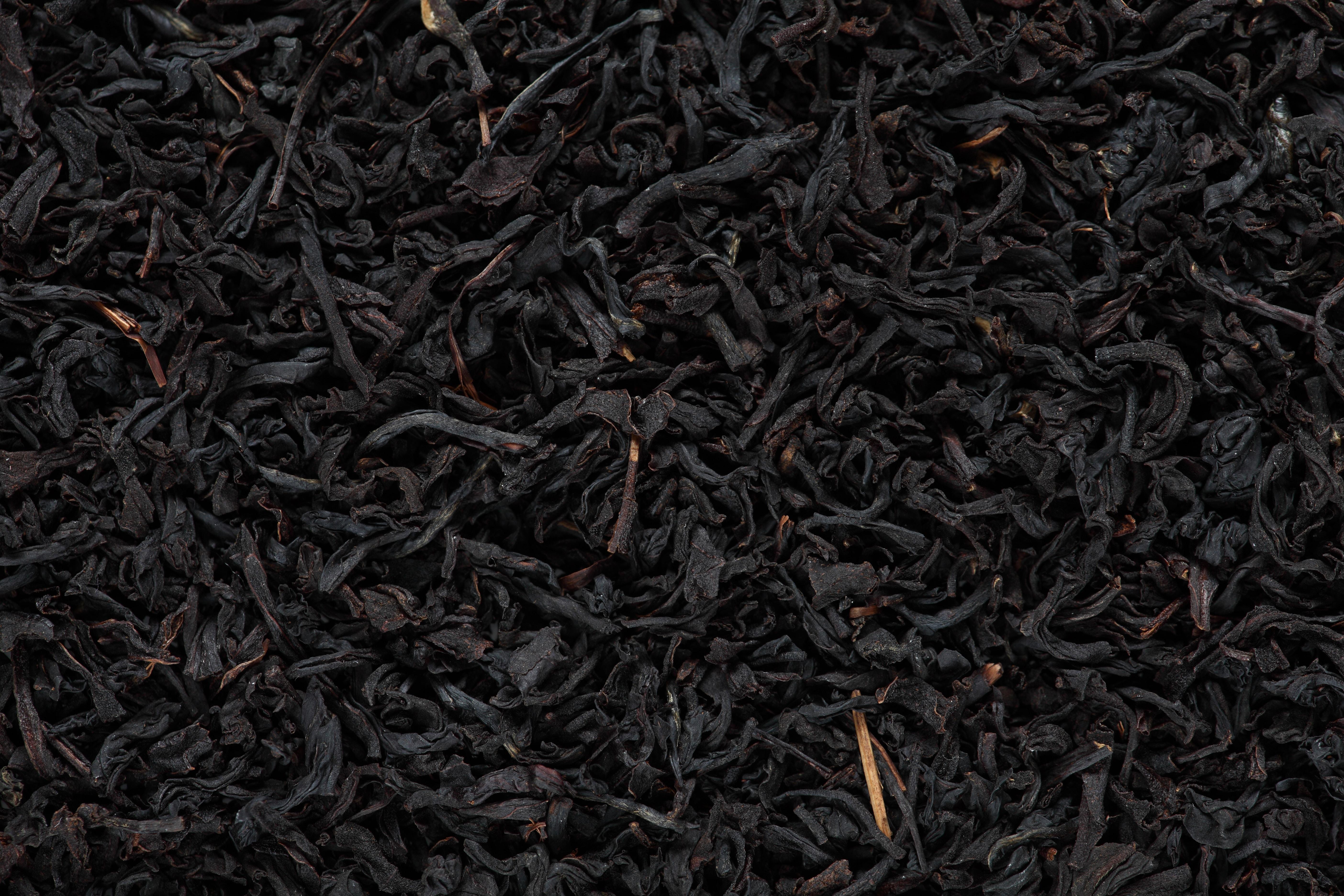 Blackened tea leaves close up