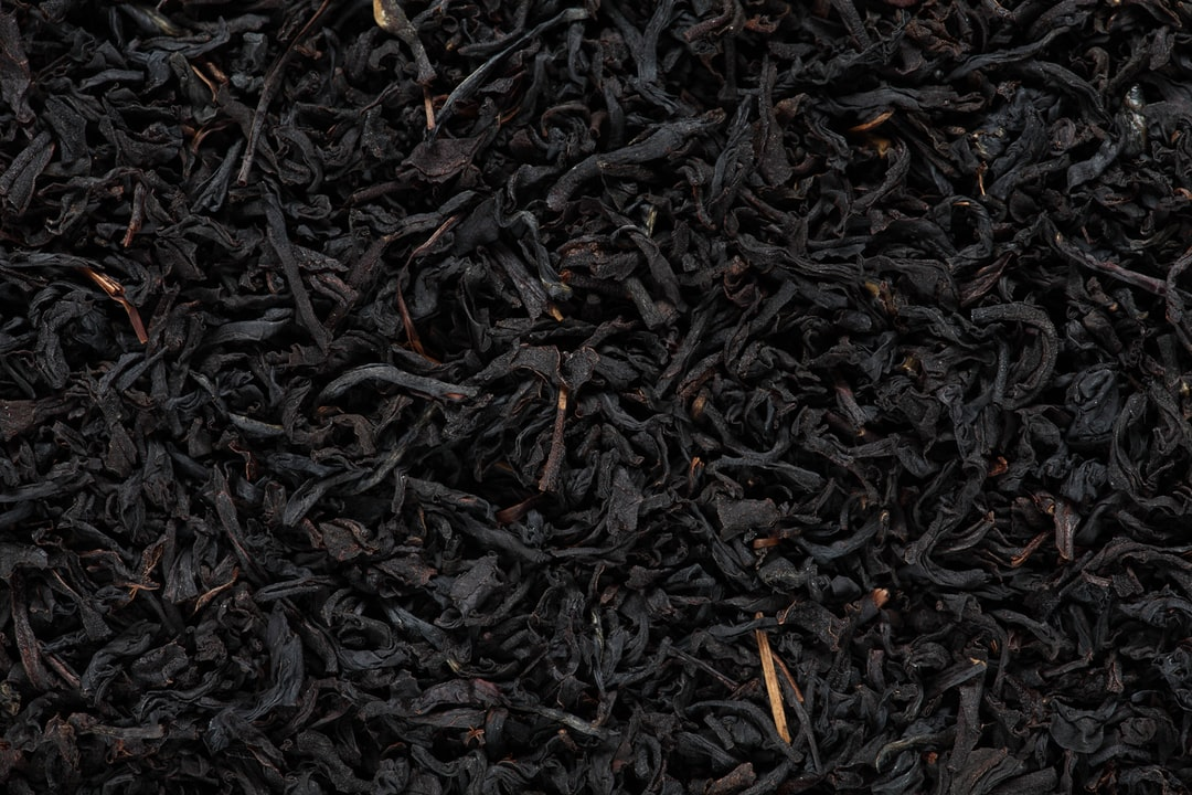 Blackened tea leaves