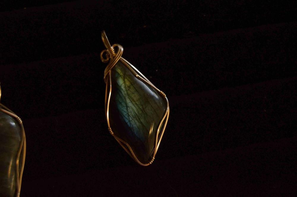 green gemstone wire wrap pendant with black background