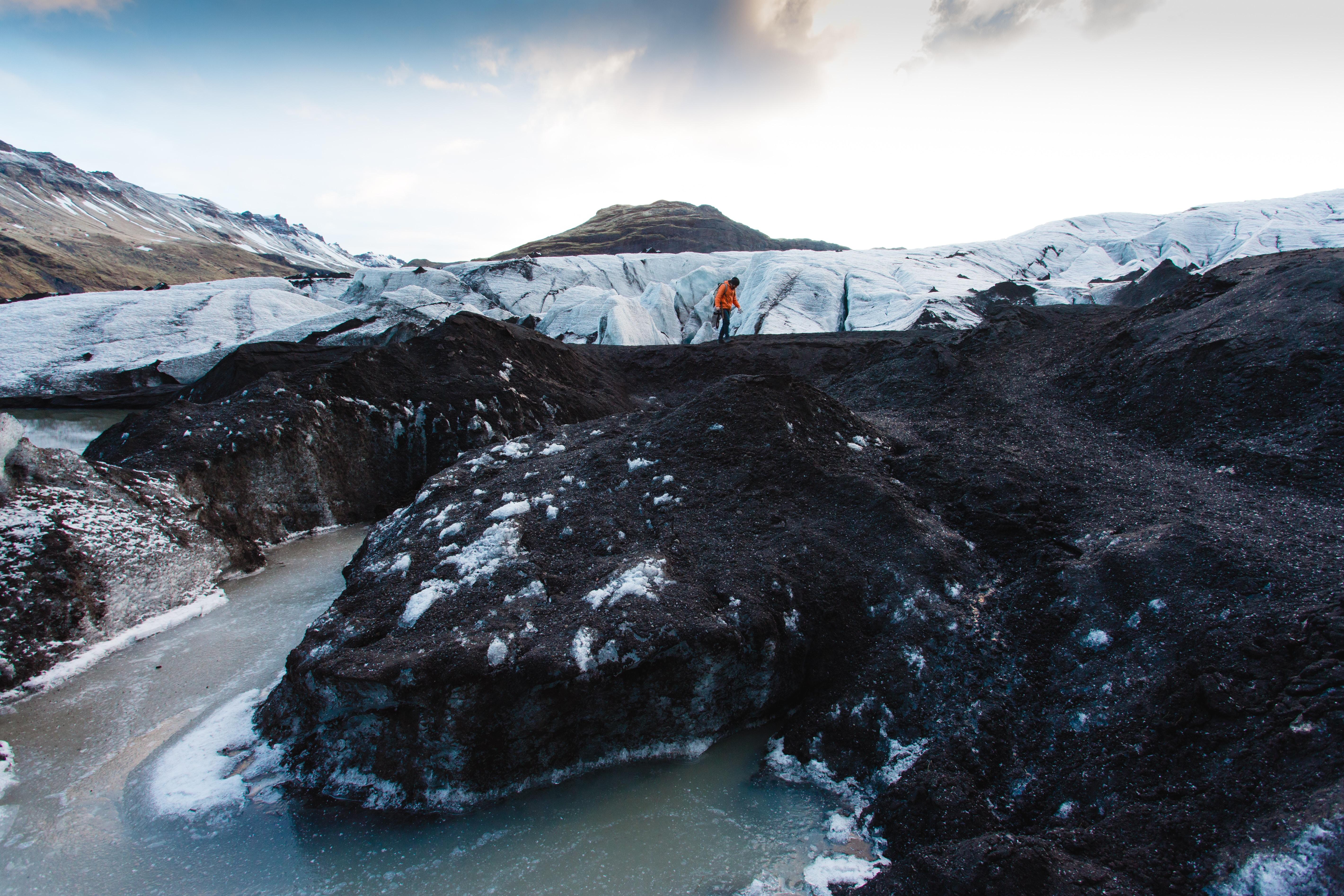 Hiker walks alone on a cold ridge near the river