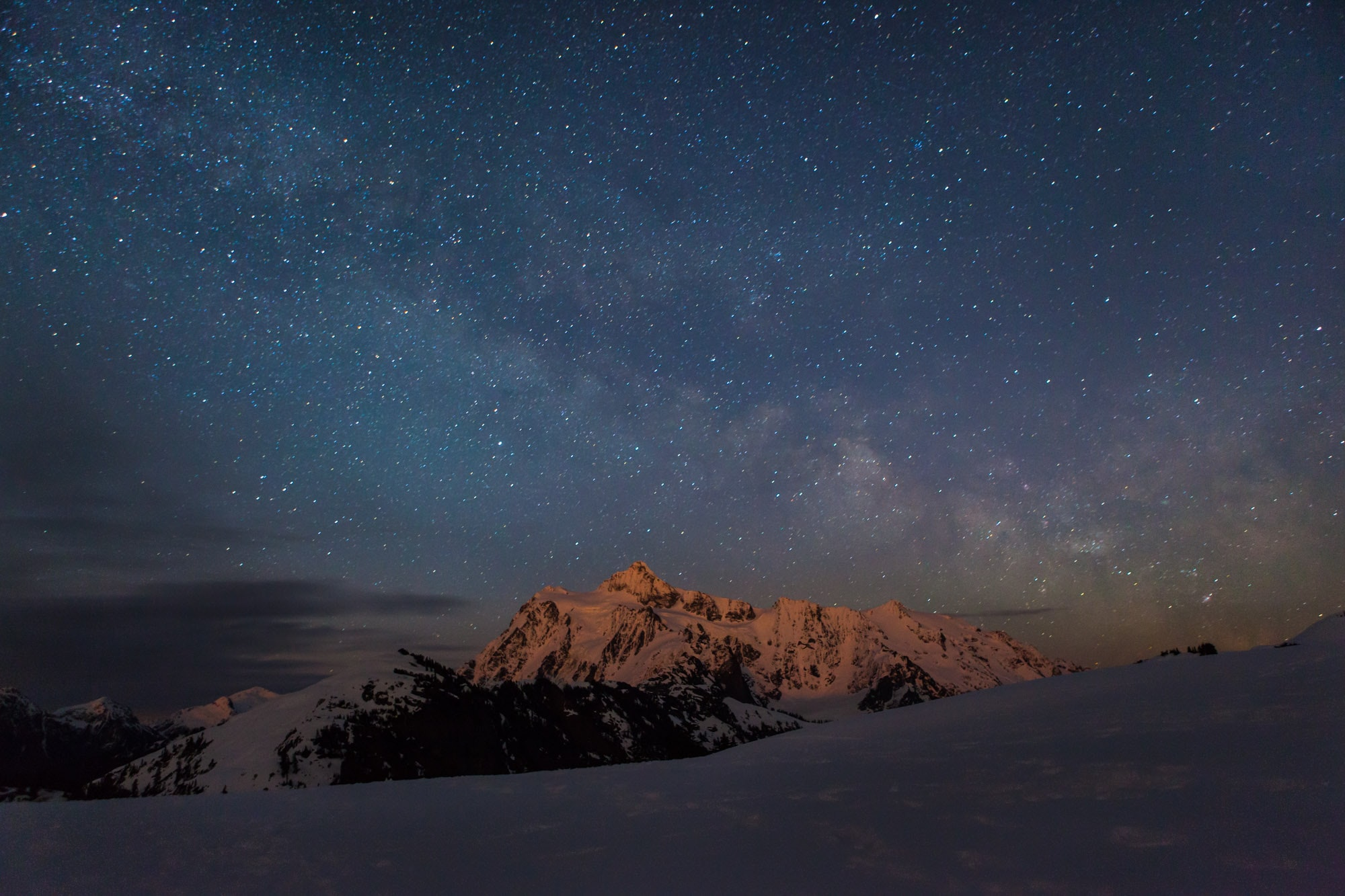 mountain covered with snow during nighttime view