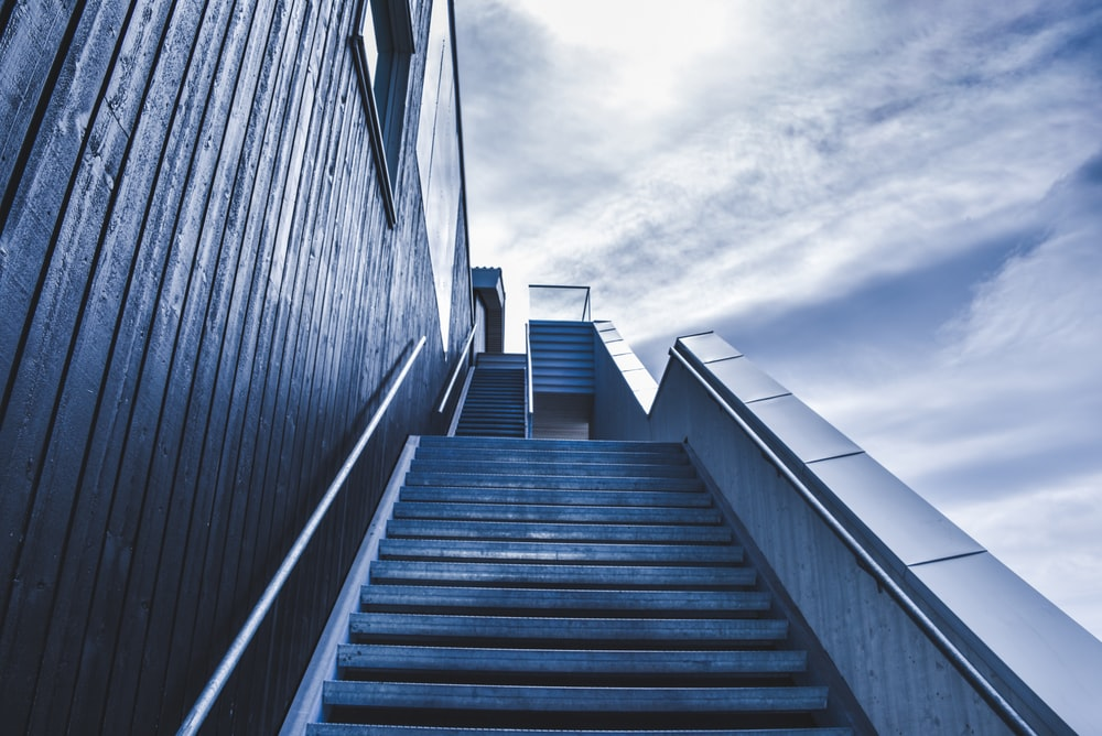 photo of staircase under blue sky during daytime