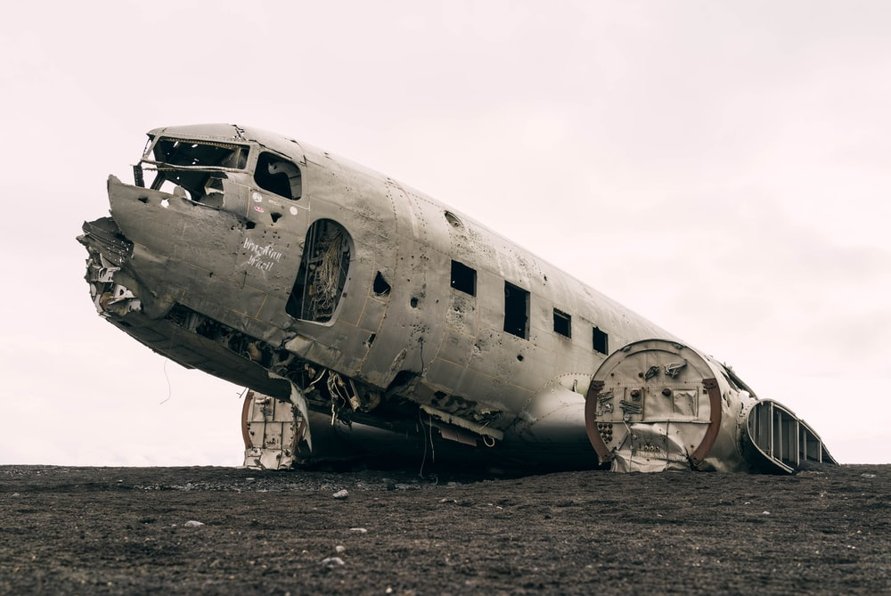 wrecked passenger plane during daytime