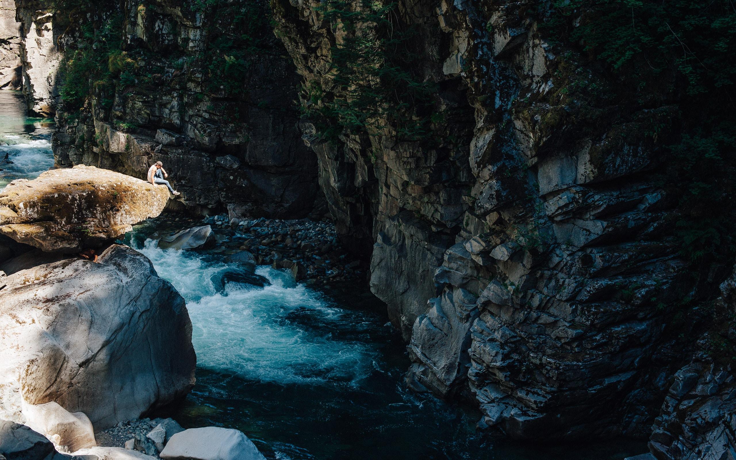 river between rock cliffs