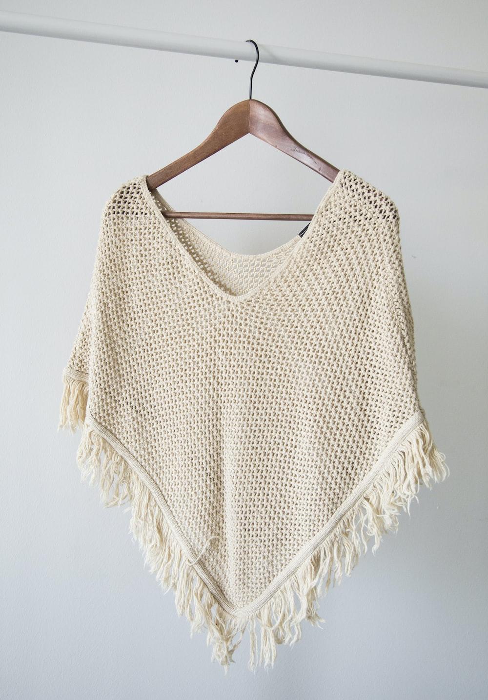 white v neck shirt on brown clothes hanger