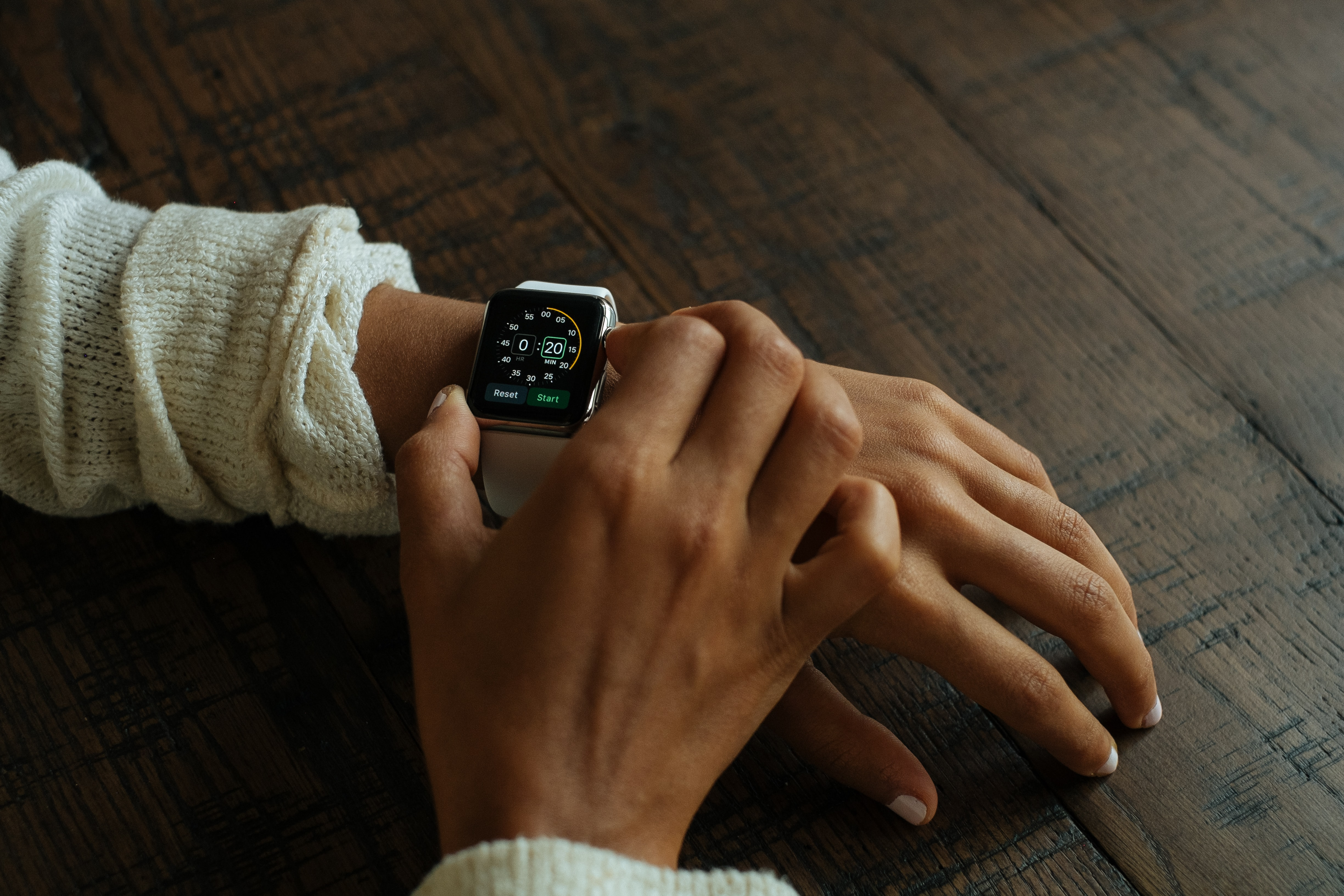 silver aluminum Apple Watch with white Sport Band