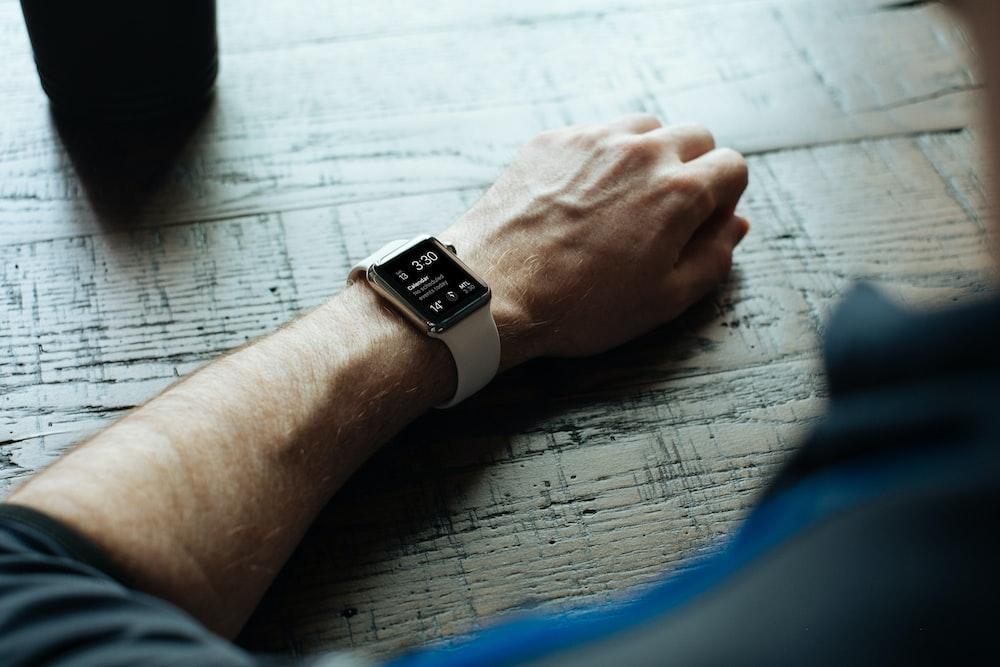 man wearing white smartwatch