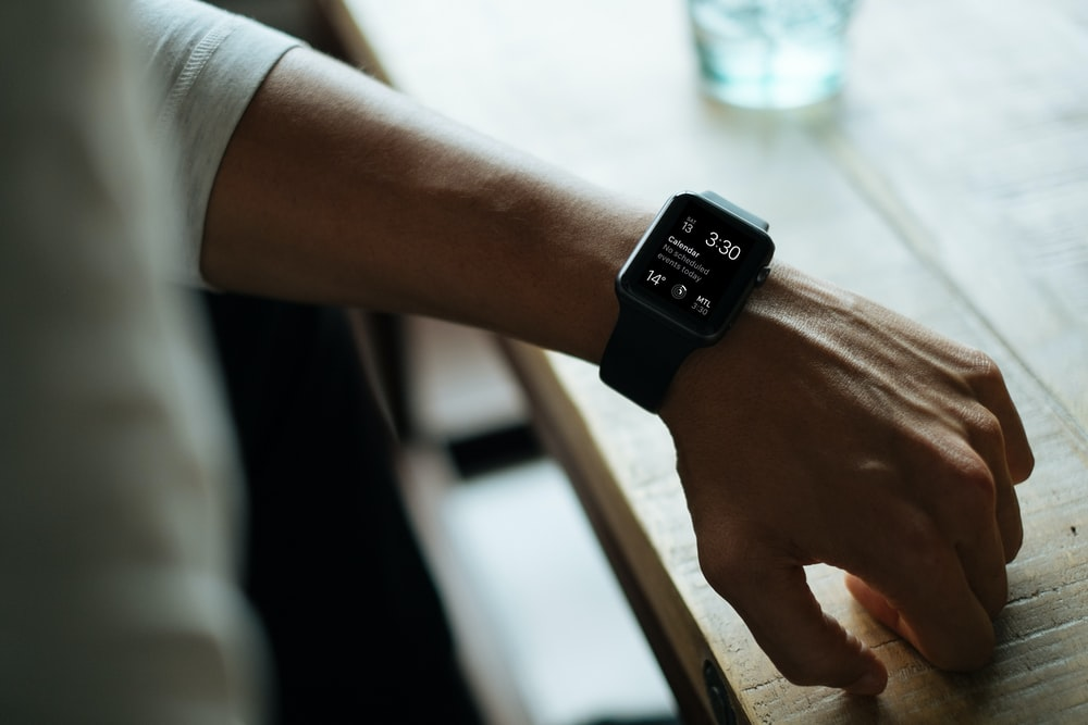 man wearing black smartwatch