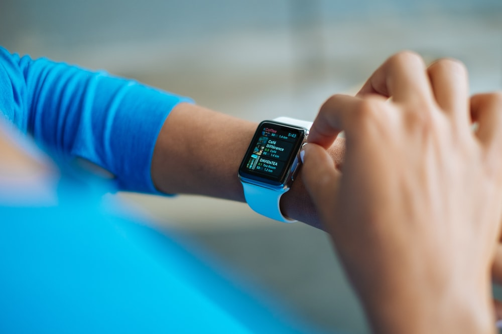 person operating smartwatch