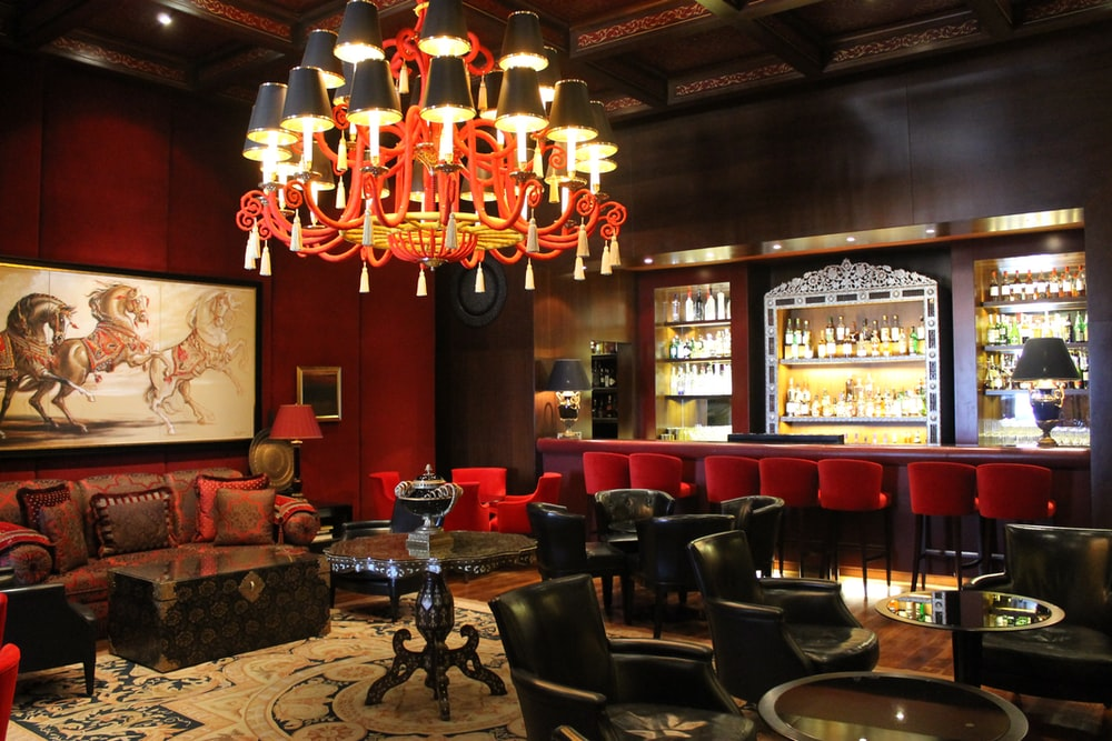 lighted chandelier inside bar
