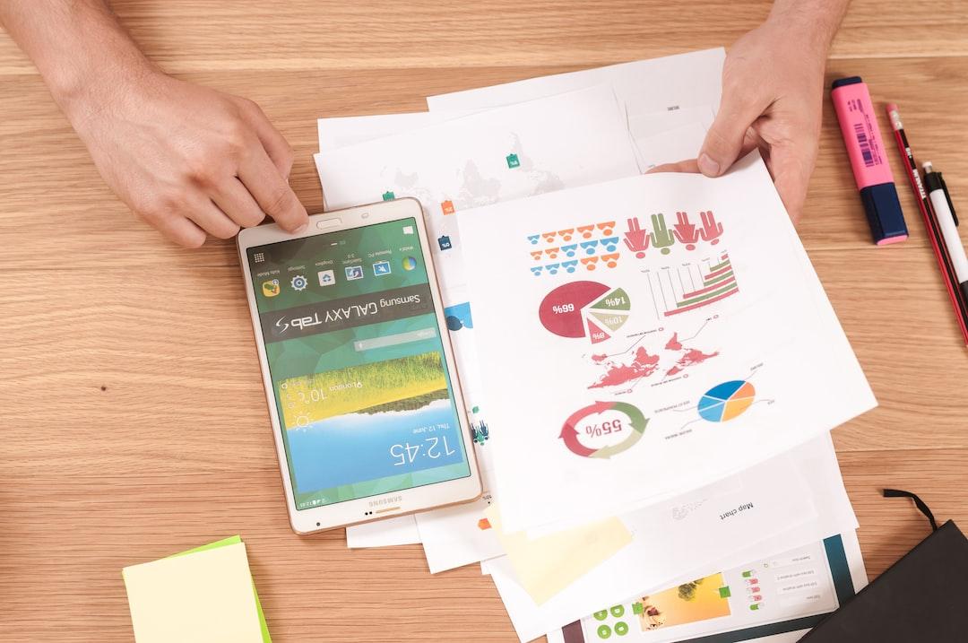 person looking at digital marketing success charts