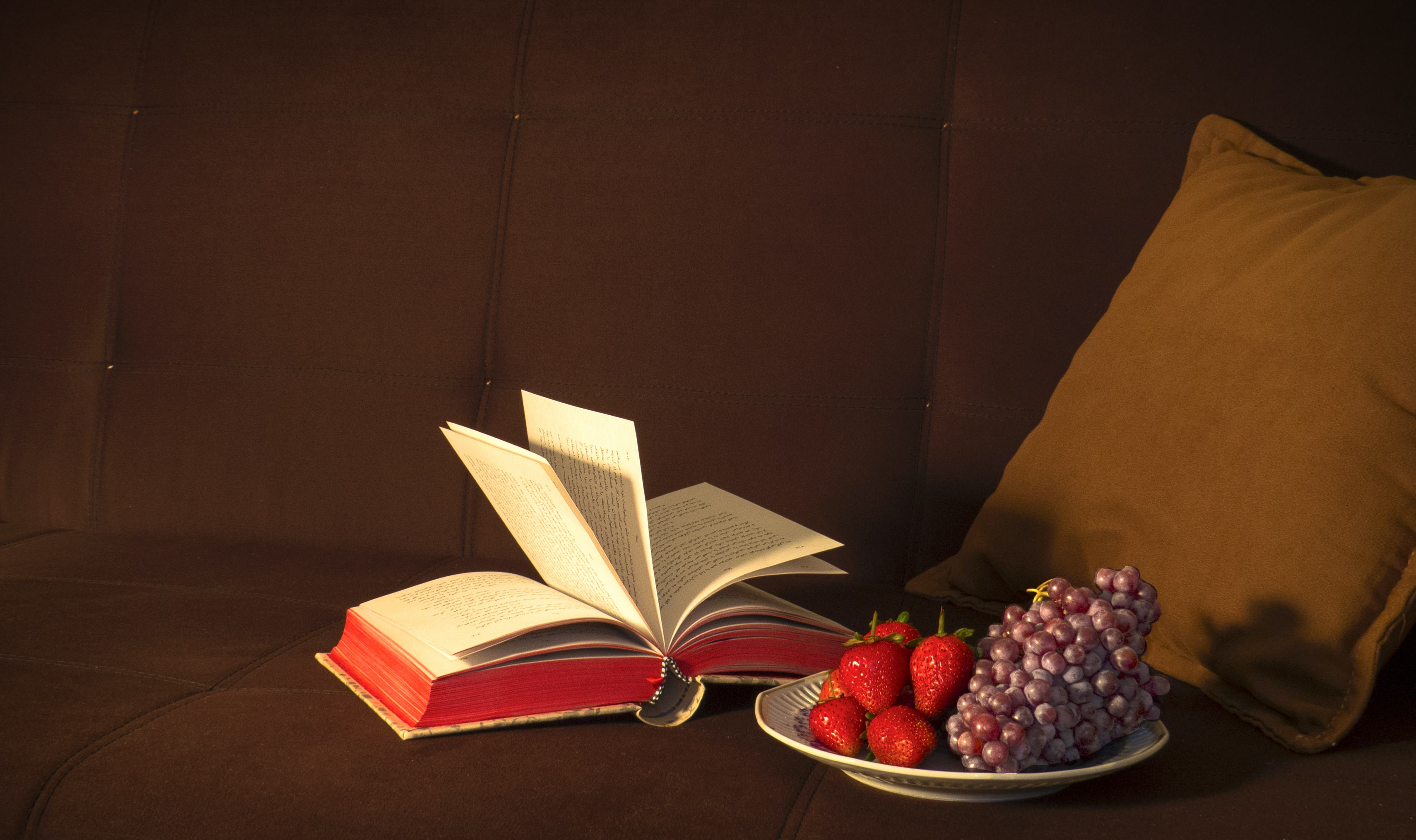 strawberries and grapes on white plate