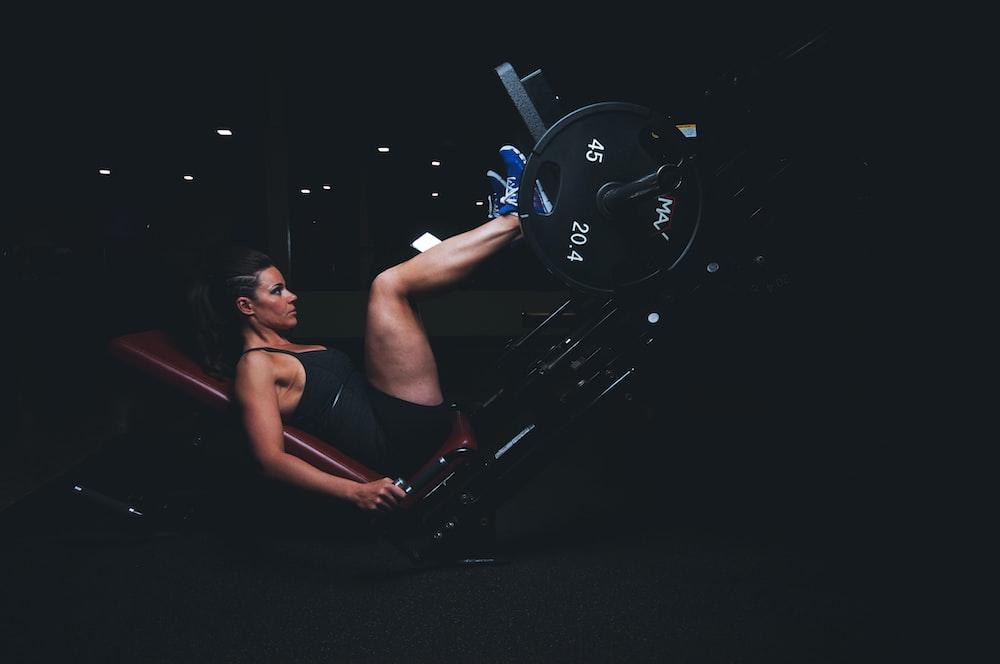 woman on gym equipment