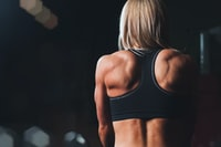 woman wearing black sports bra facing front selective focus photography