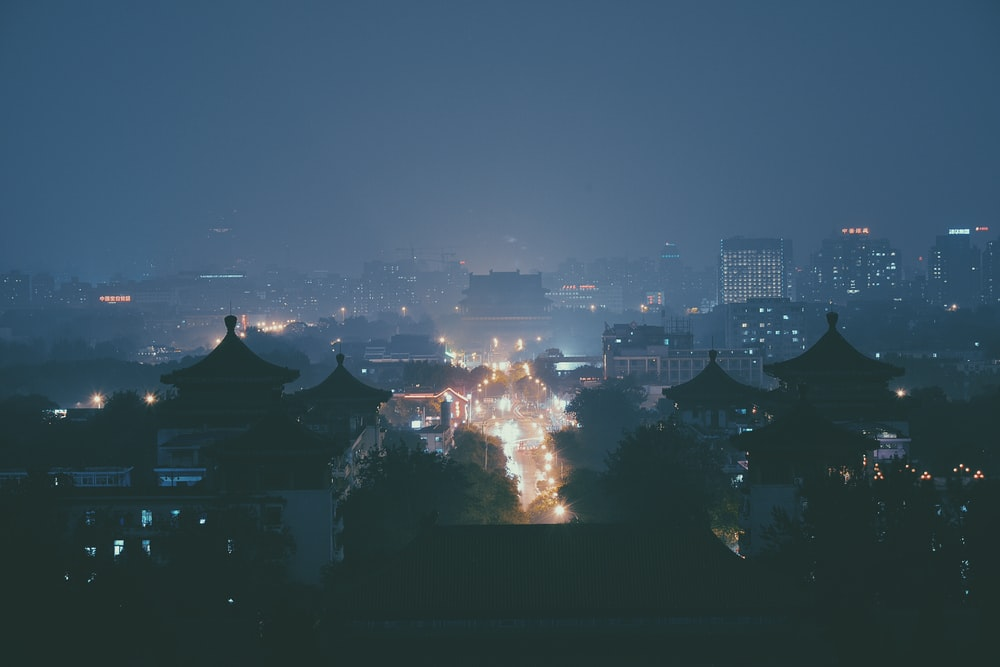 above ground photo of city with lights turned on