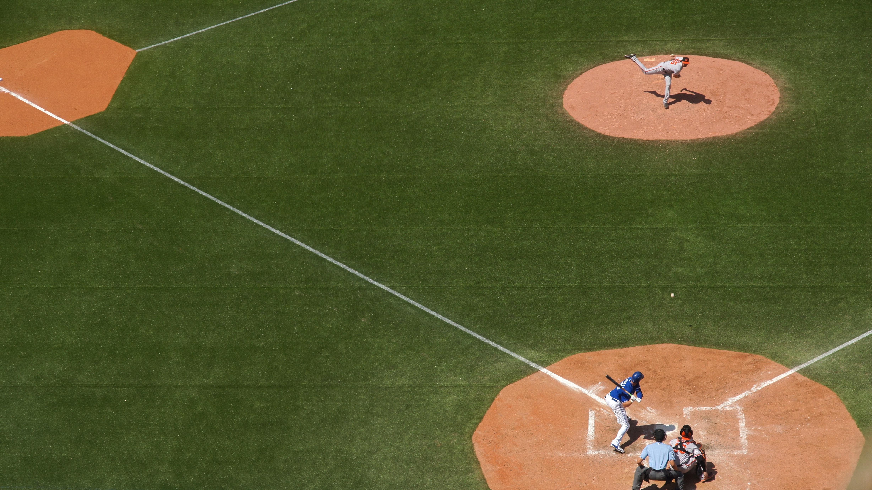 baseball player playing baseball in ballpark