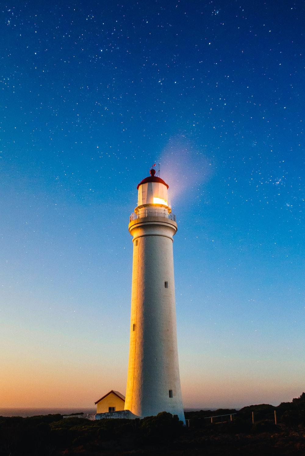 white concrete lighthouse