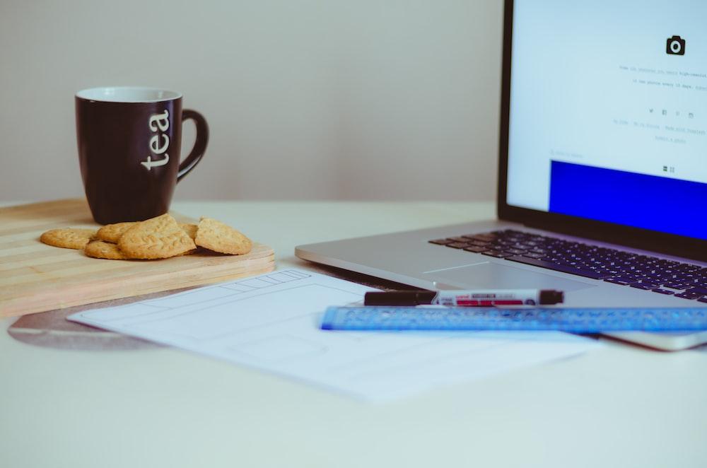 pastry beside ceramic mug
