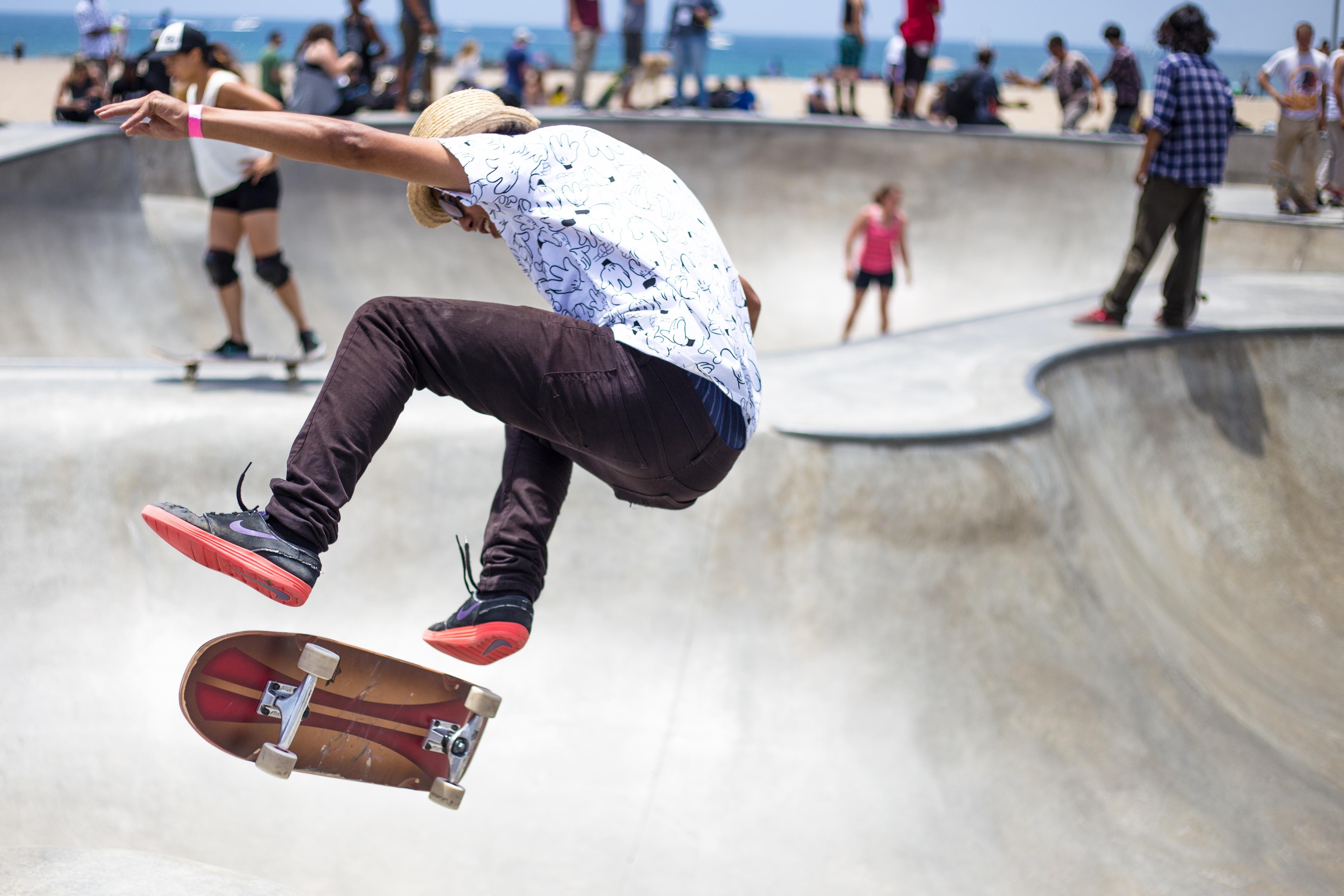 people playing skateboard on skateboard park