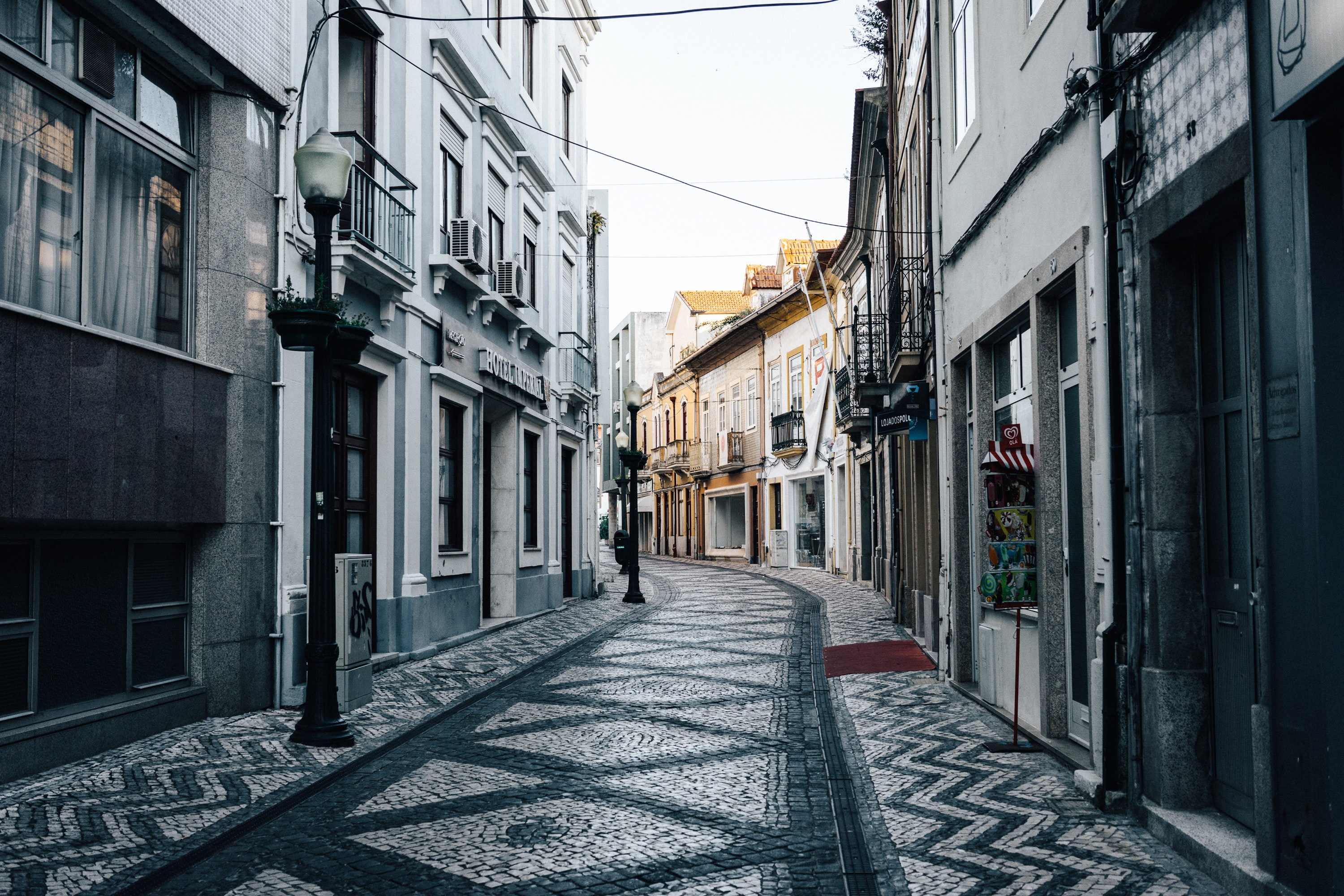 Cobblestone street and European architecture form a narrow path
