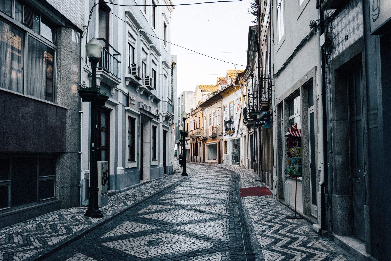 Cobblestone street and European architecture form a narrow path