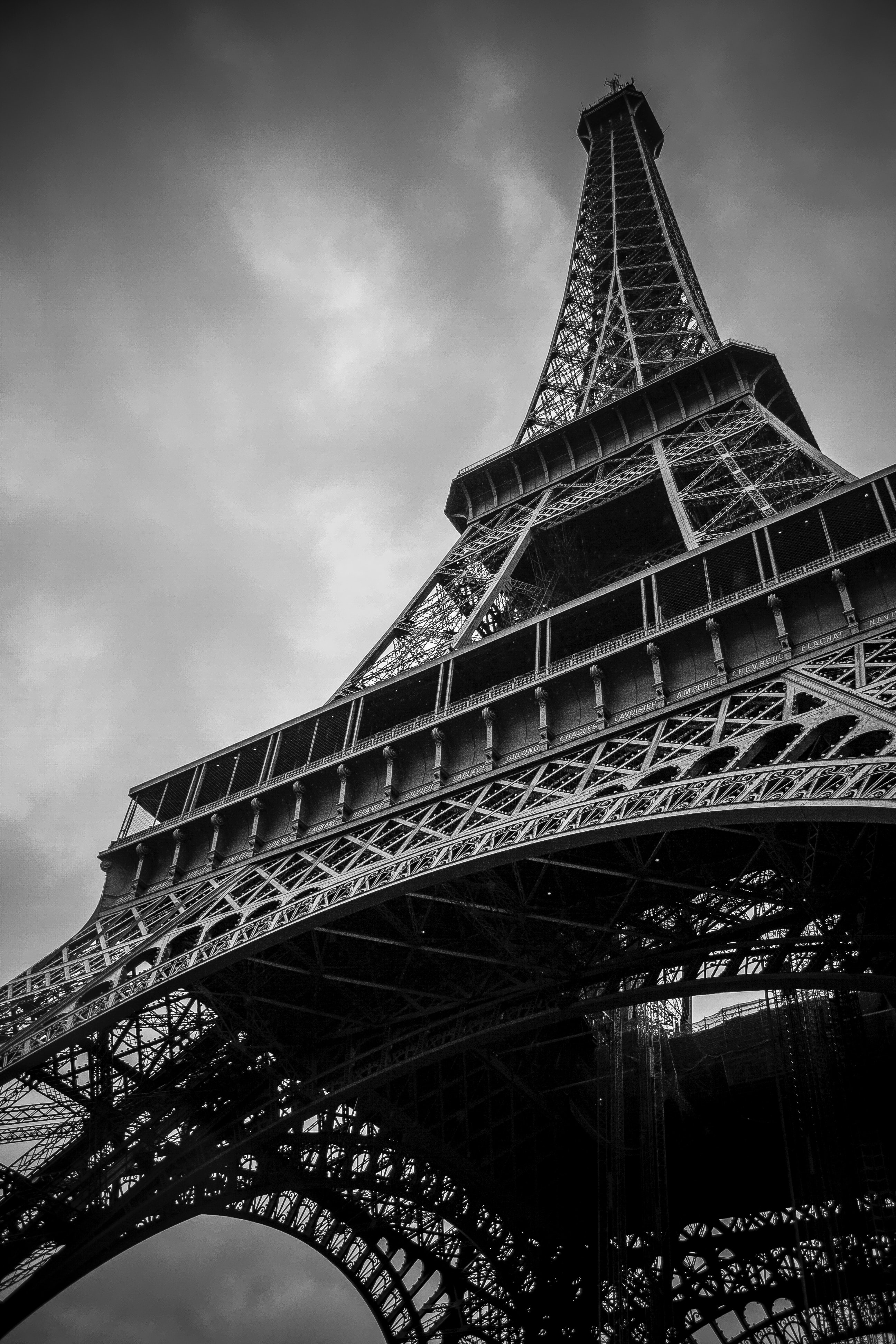 A low-angle shot of the Eiffel Tower in Paris on a cloudy day