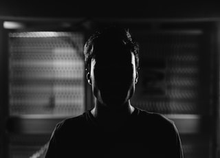 man's face grayscale photo