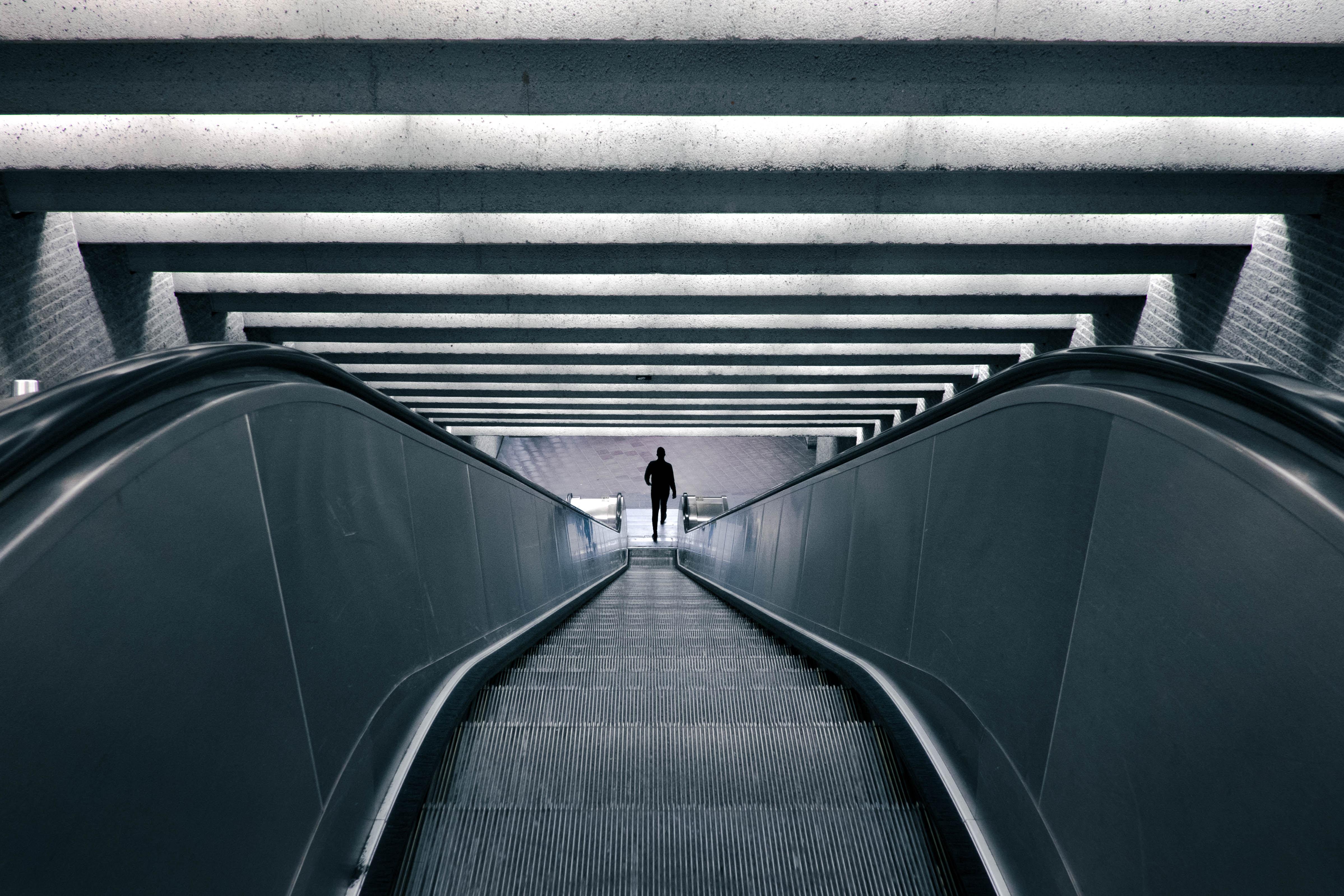 man on escalator turned on