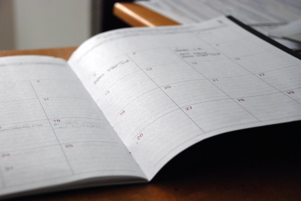 An open calendar with short notes scribbled next to the dates