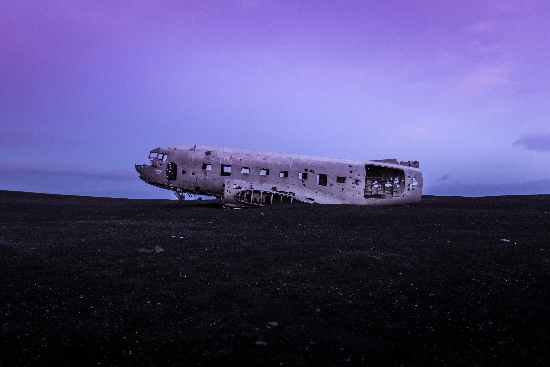 crashed airplane on brown soil