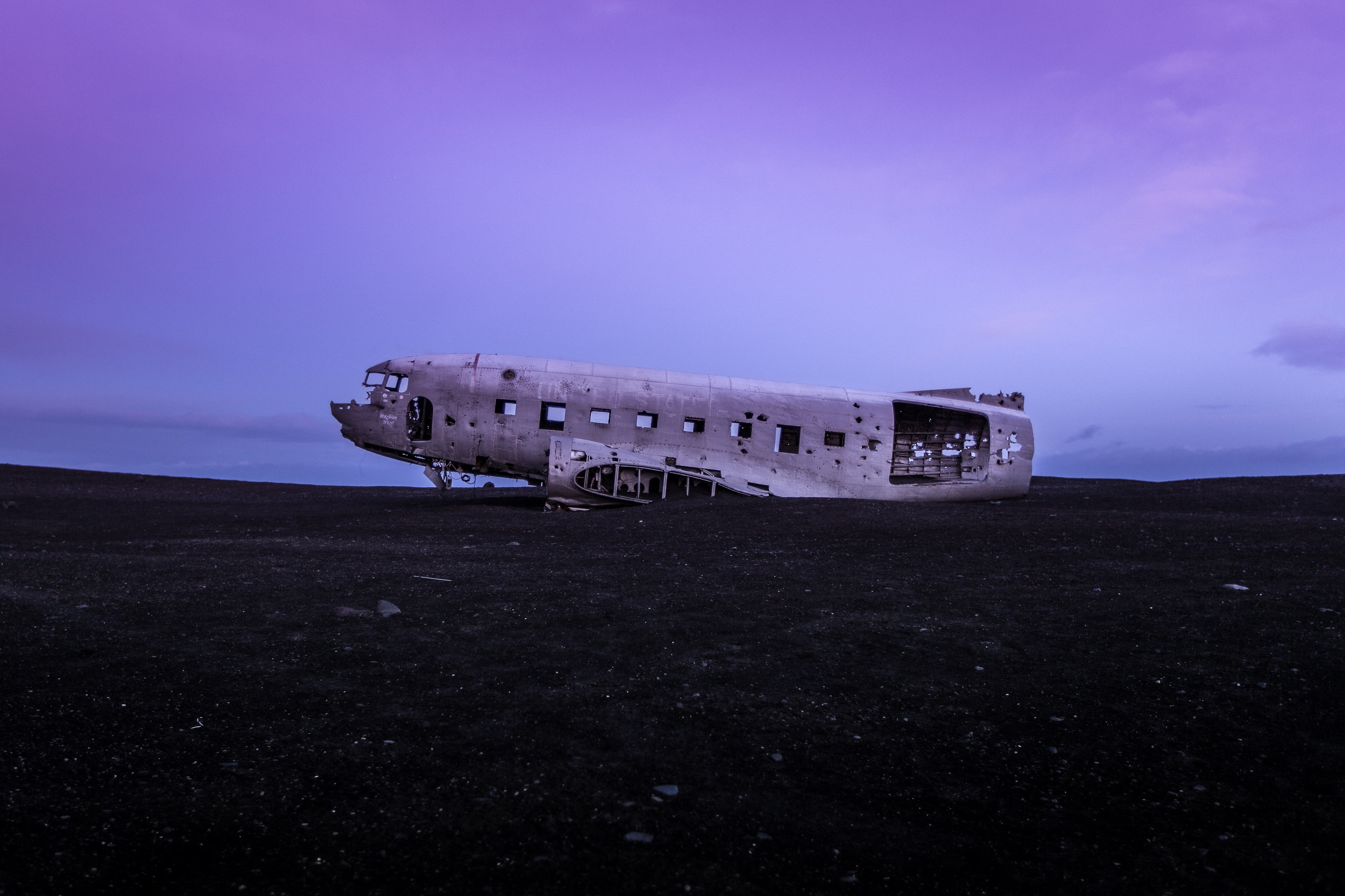 crashed airplane on brown soil