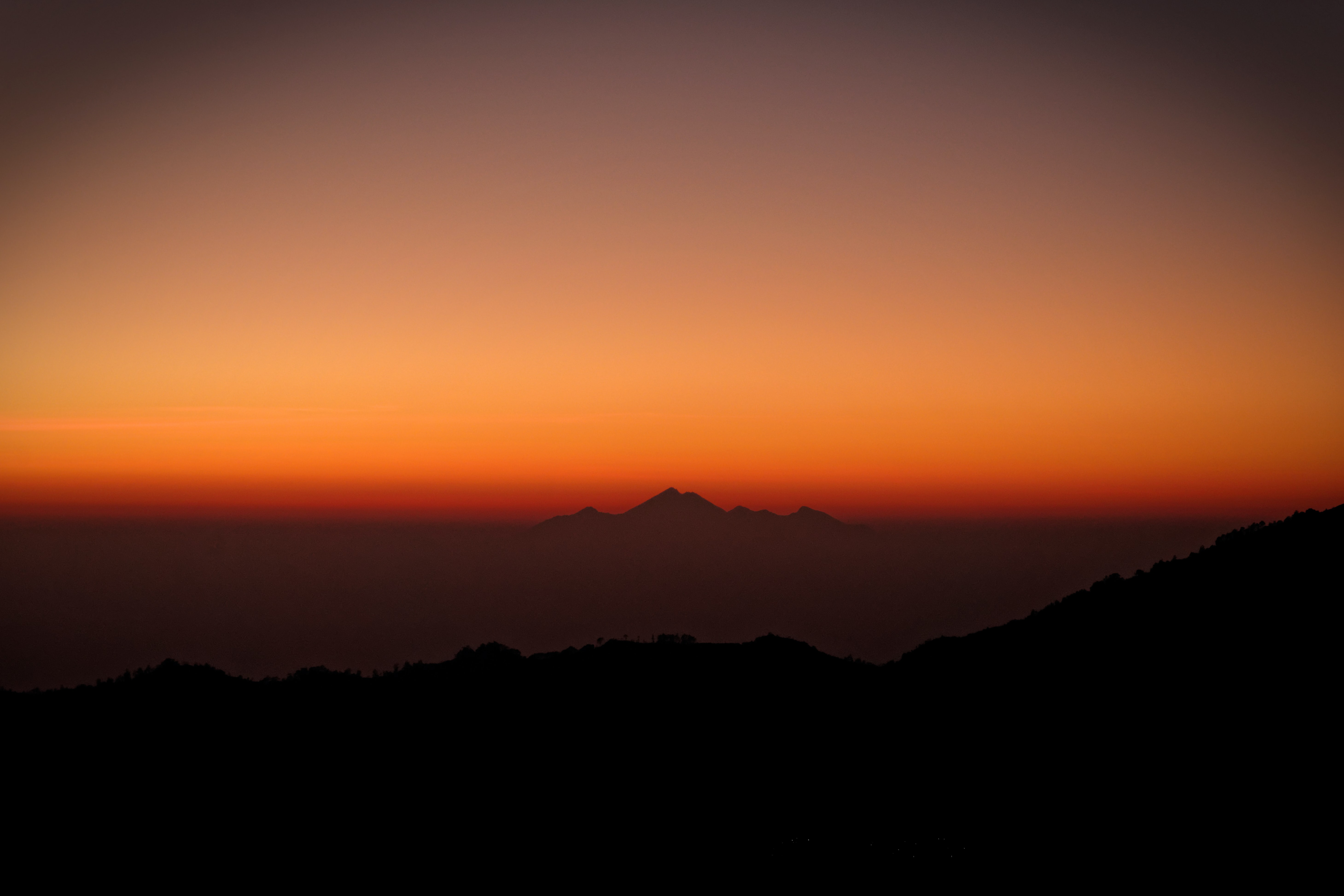 silhouette photography of mountains during sunset