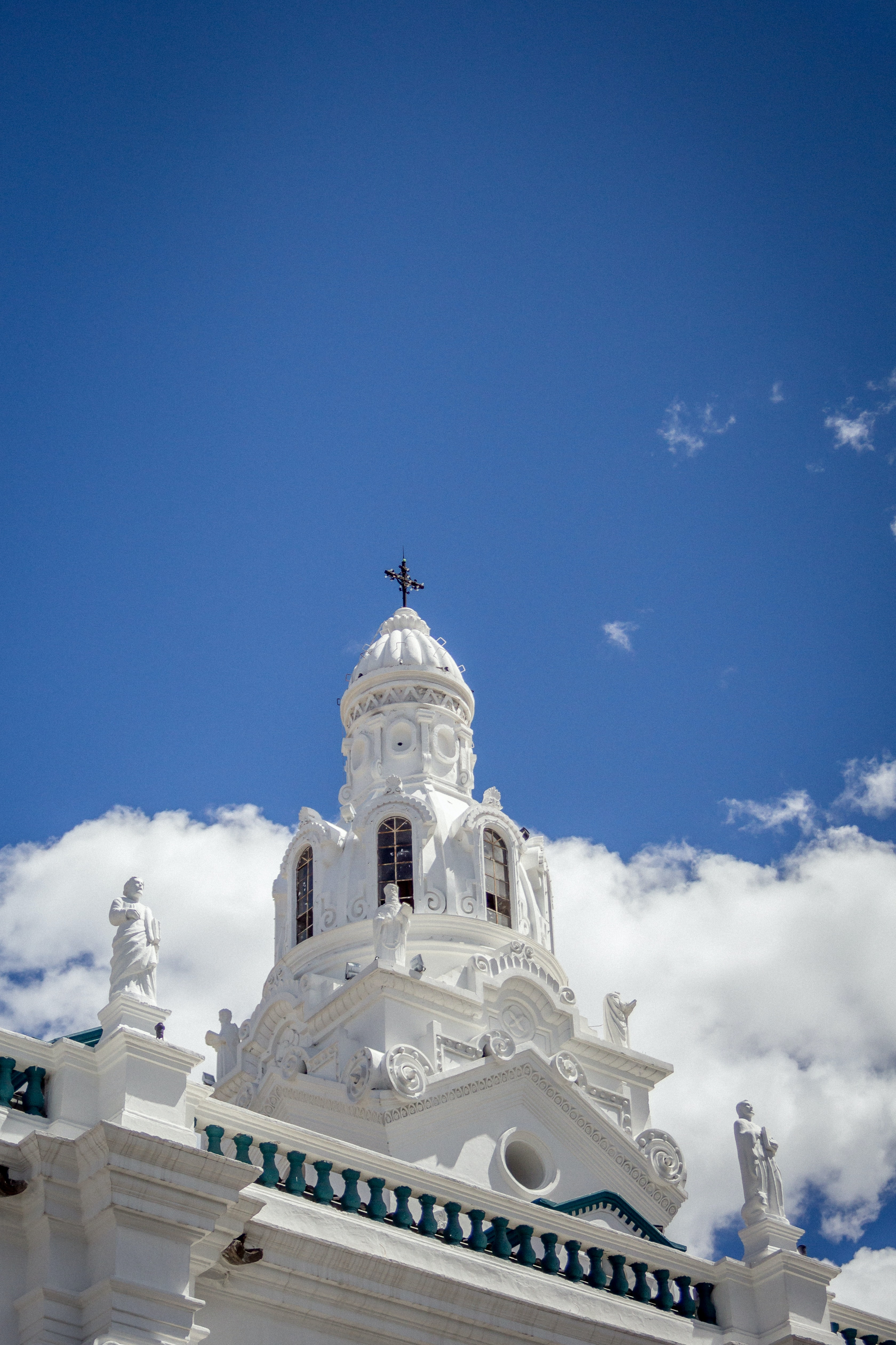 low-angle photography of white concrete cathedral