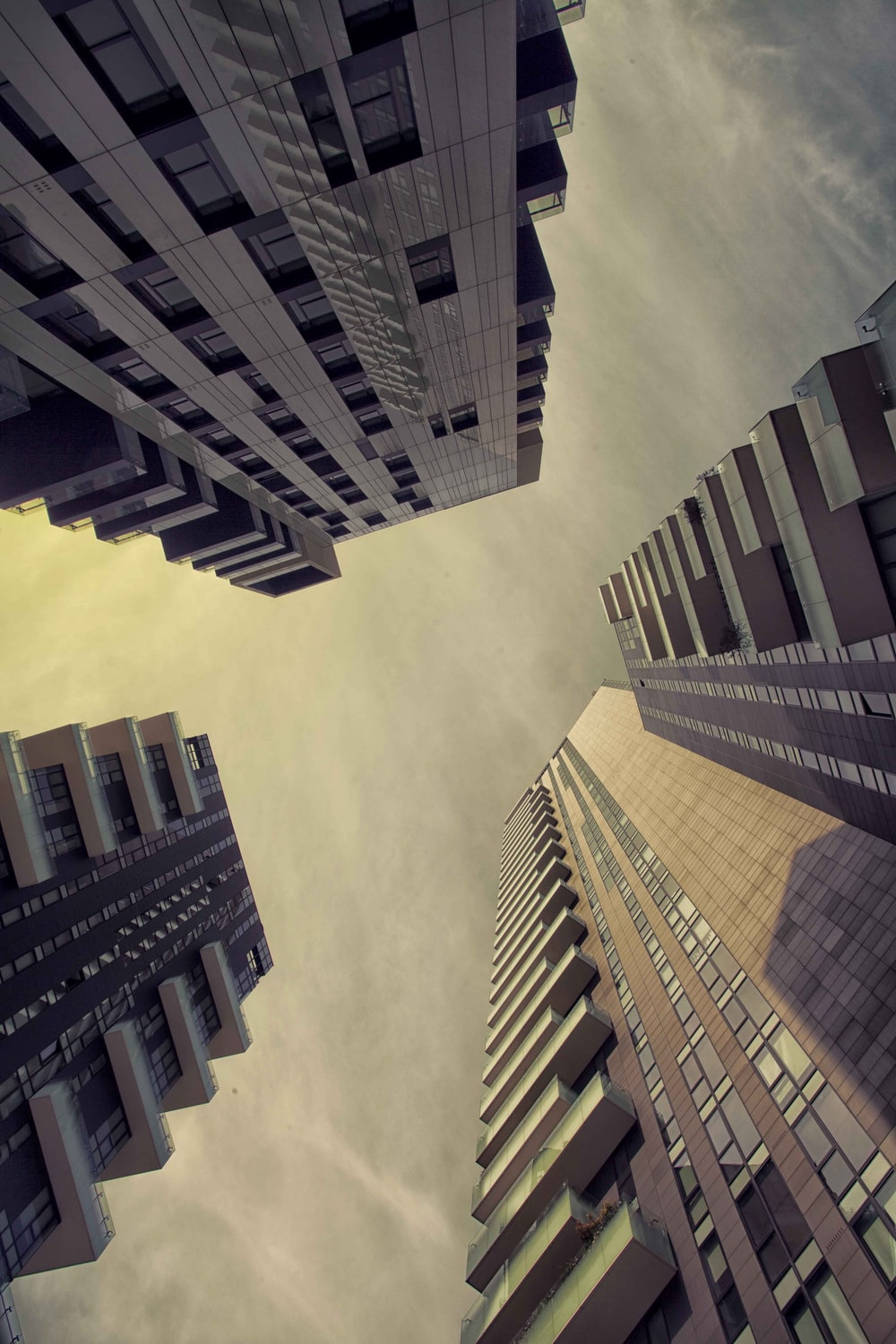 worm's eye view photography of three high-rise buildings