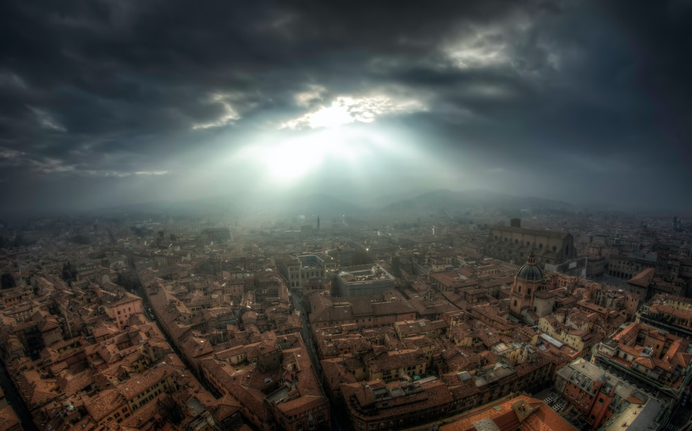 aerial photography of city under gray clouds