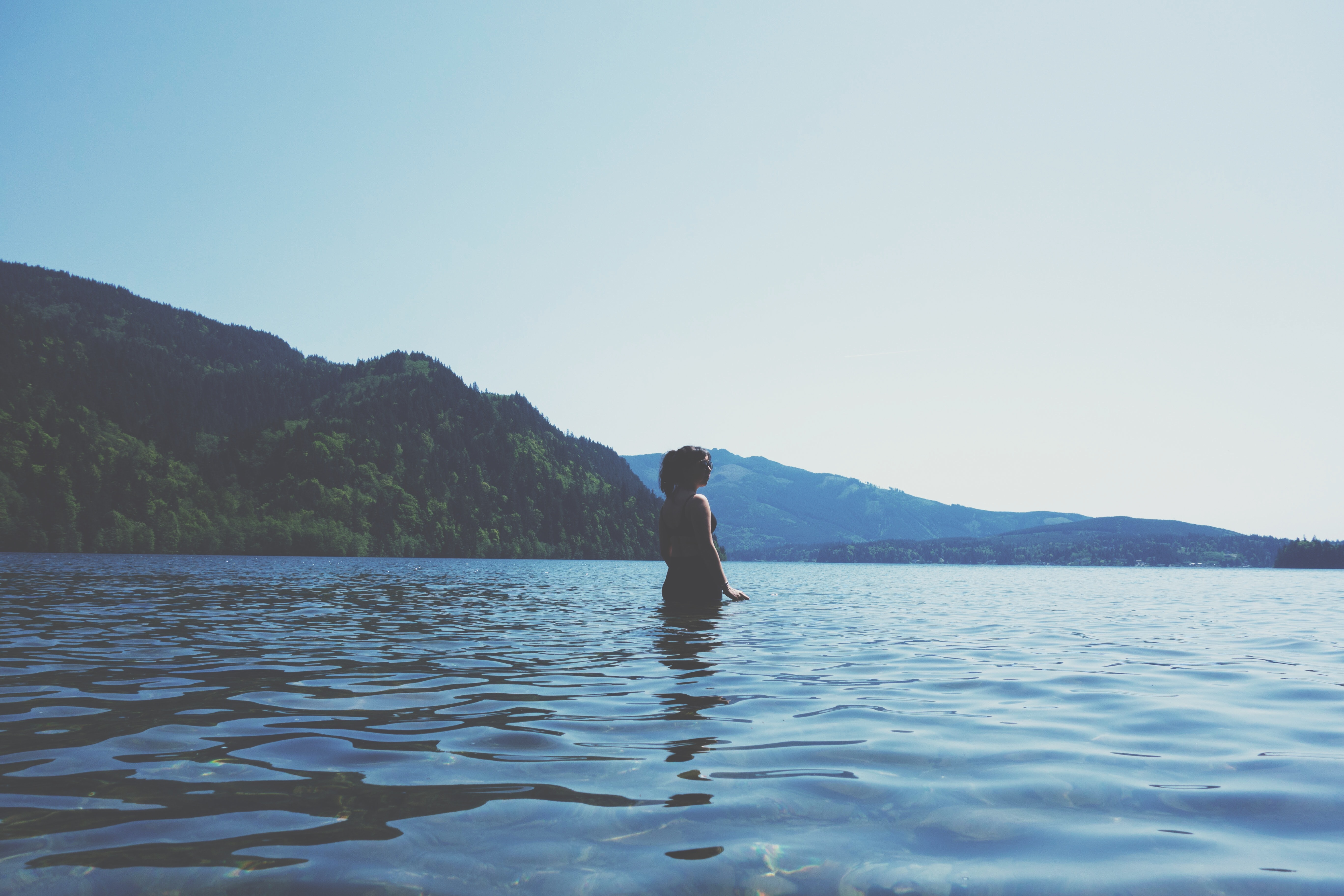 woman half-submerged in water