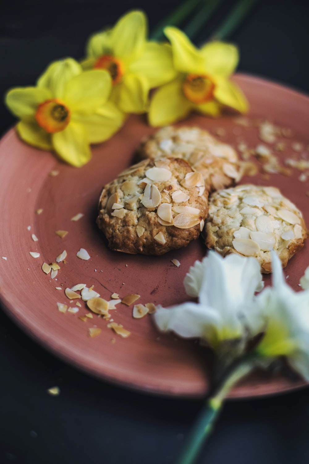 oatmeal cookies and daffodil flowers on plate