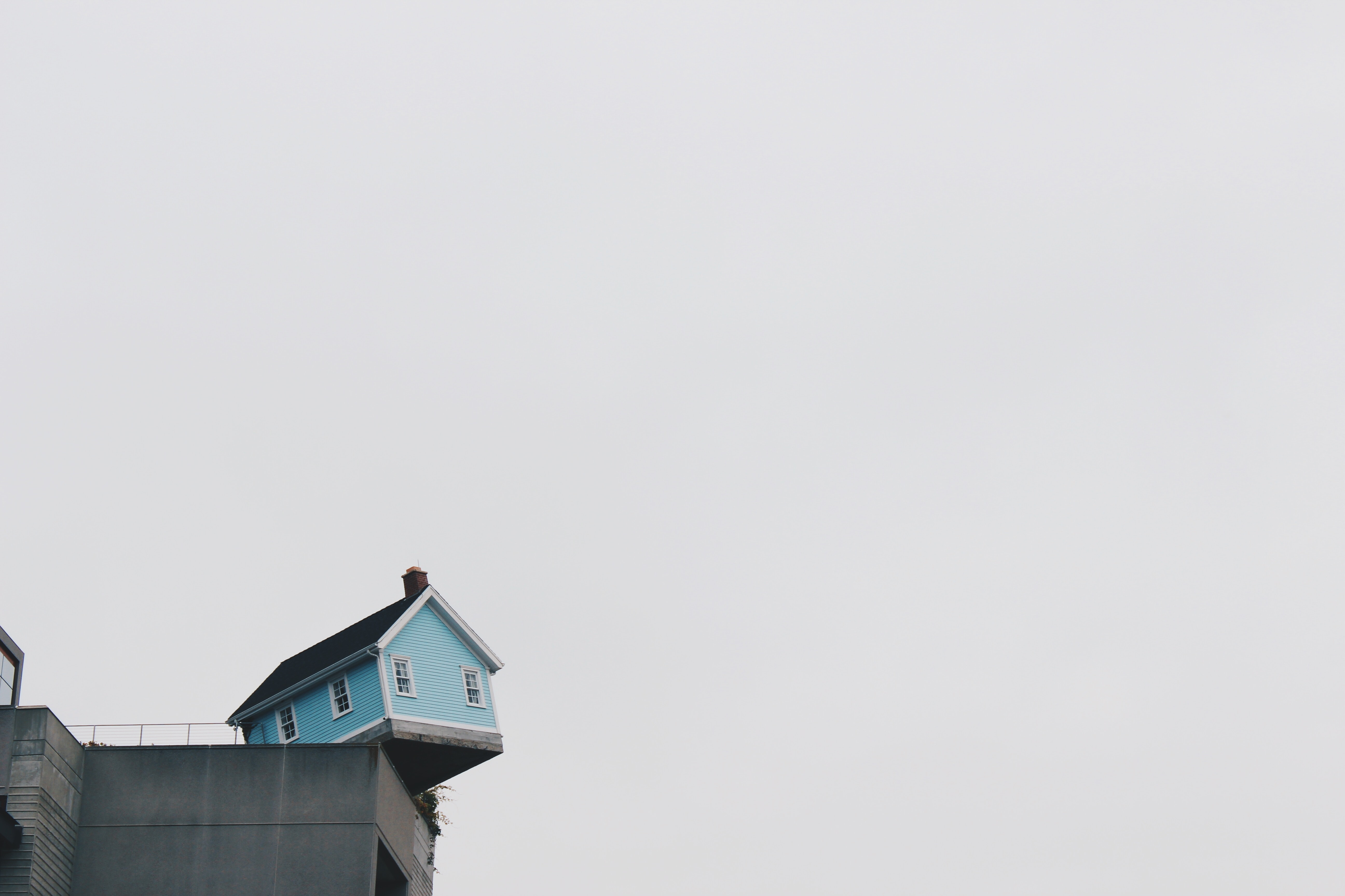 blue concrete storey house on top of building at daytime