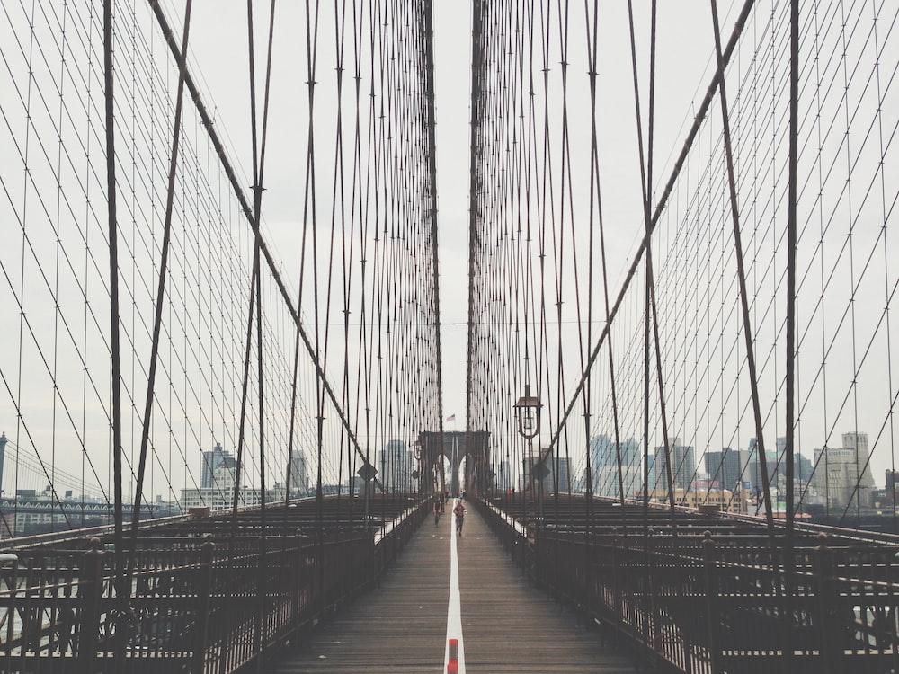 person running on bridge