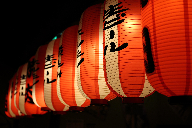 A line of lit lanterns arranged on a platform