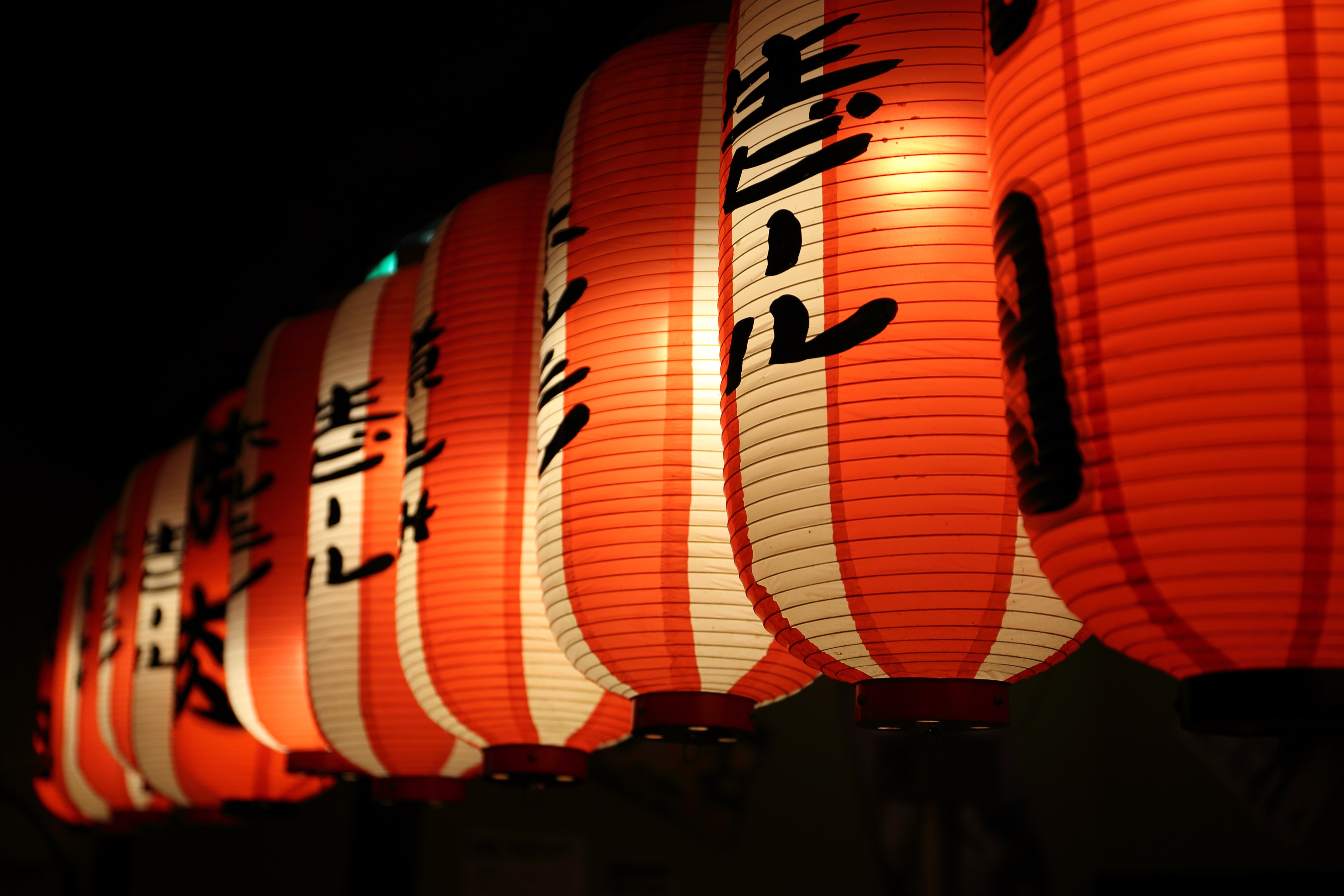 selective focus photography of lit paper lanterns