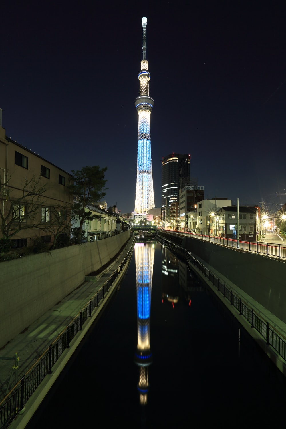 blue and white lighted tower during night time
