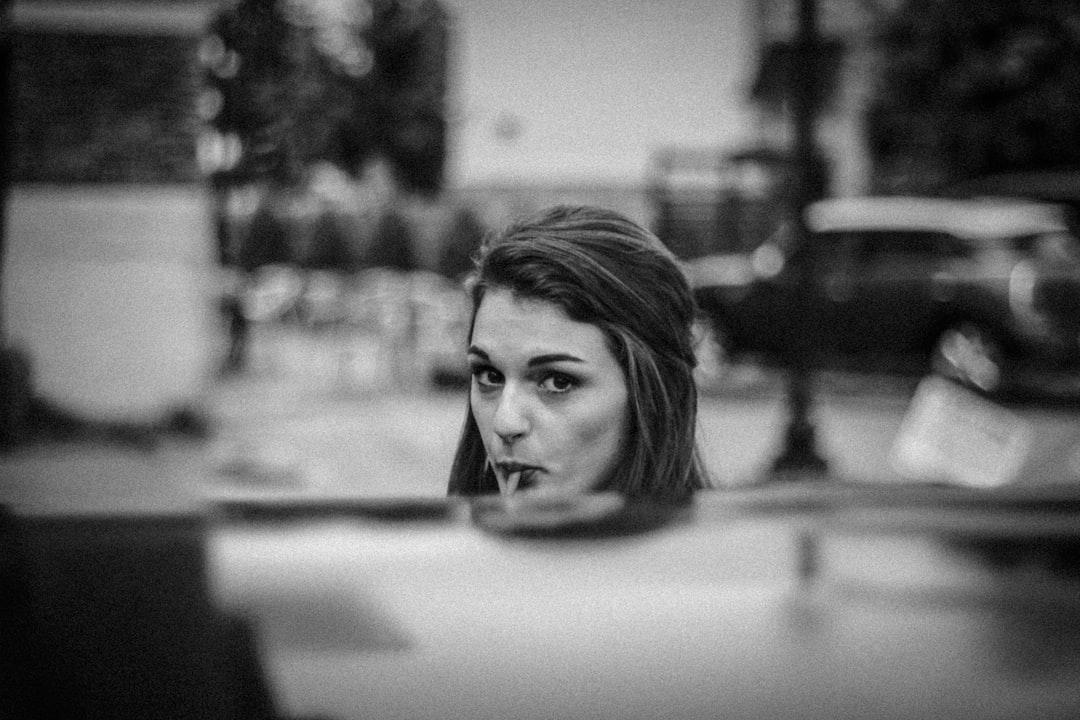 monochrome woman sucking
