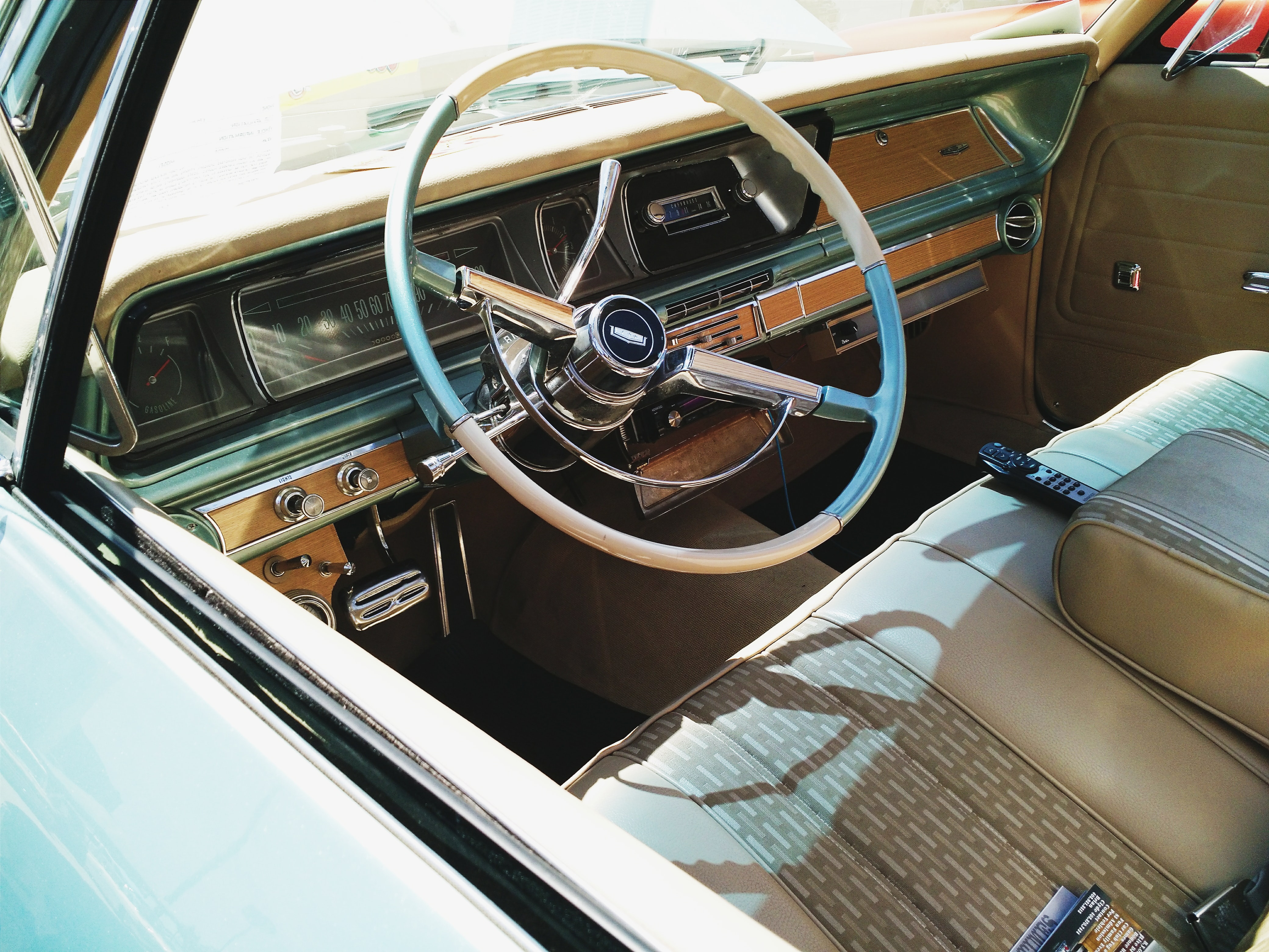 Steering wheel and dashboard of the vintage automobile.