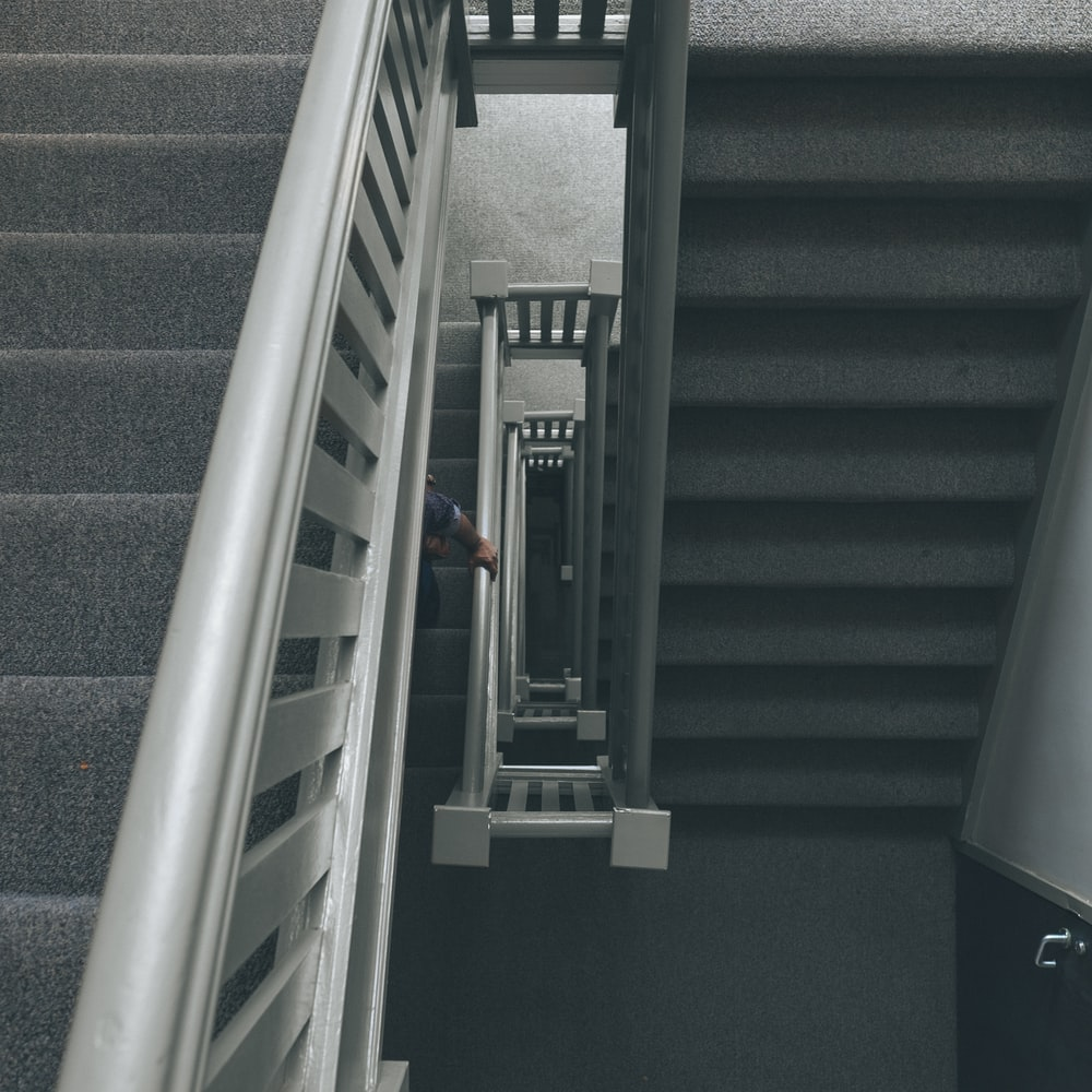 photo of grey staircase with grey metal railings