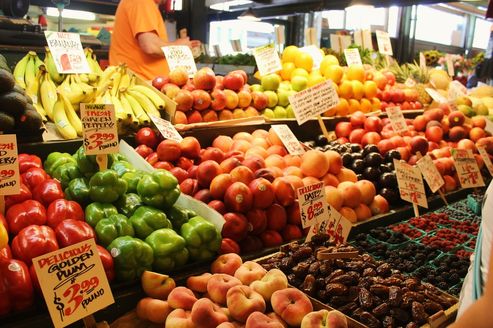red and green apples on display