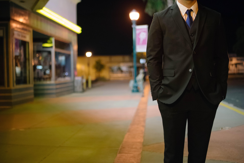 man walking on standing putting is hands inside pocket