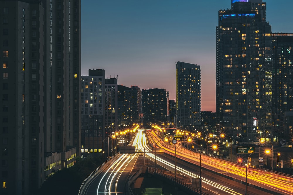 time lapse photography of highway during nighttime