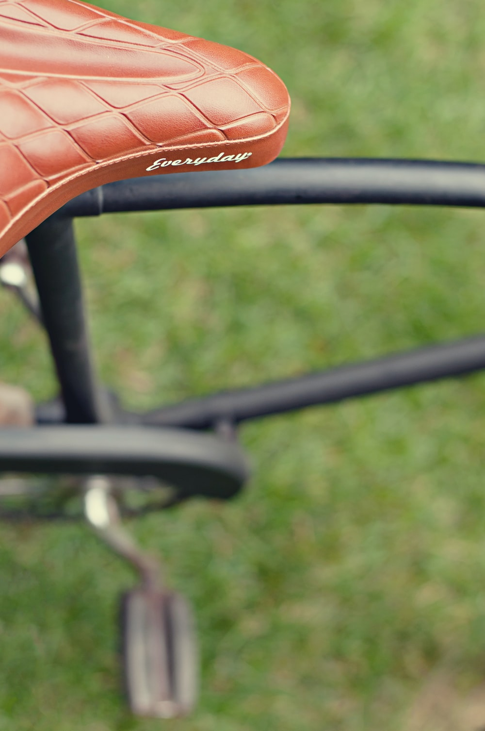 selective focus photography of brown Everyday leather bicycle saddle
