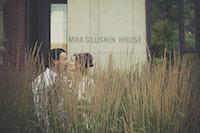 woman and man kissing near Max Gluskin House building